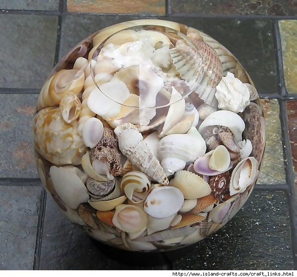 I found this on aisledash.com, it would be a great DIY centerpiece. Just fill a glass globe, or vase with shells and water, add a touch of water purifier to keep it fresh, and you have a lovely decorative centerpiece. Shells can be found a craftstore