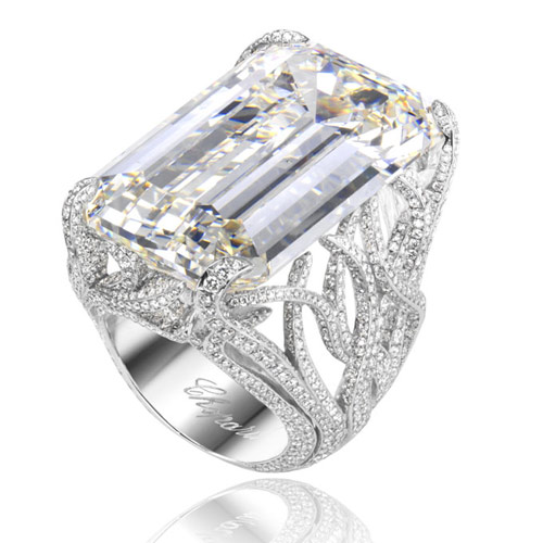 Chopard 18k white gold and diamond engagement ring with emerald-cut center stone.