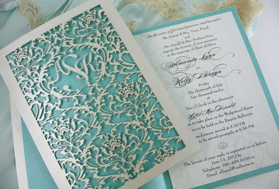 Laser cut wedding invites a popular paper trend bravobride this gorgeous laser cut booklet covers from katblustudio could be used for wedding programs or invitations and incorporates the delicate yet popular damask filmwisefo
