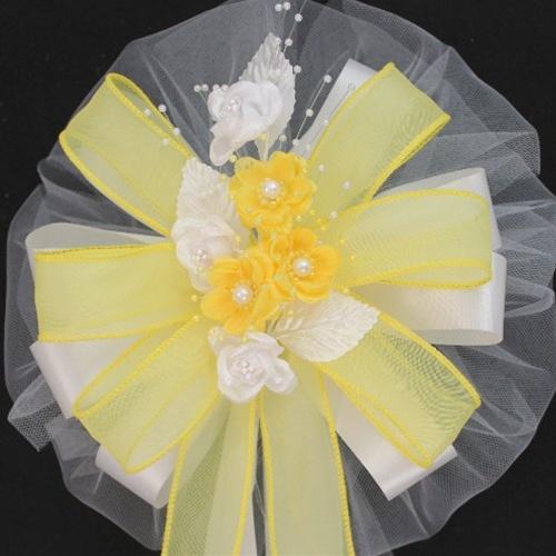 yellow white wedding bows