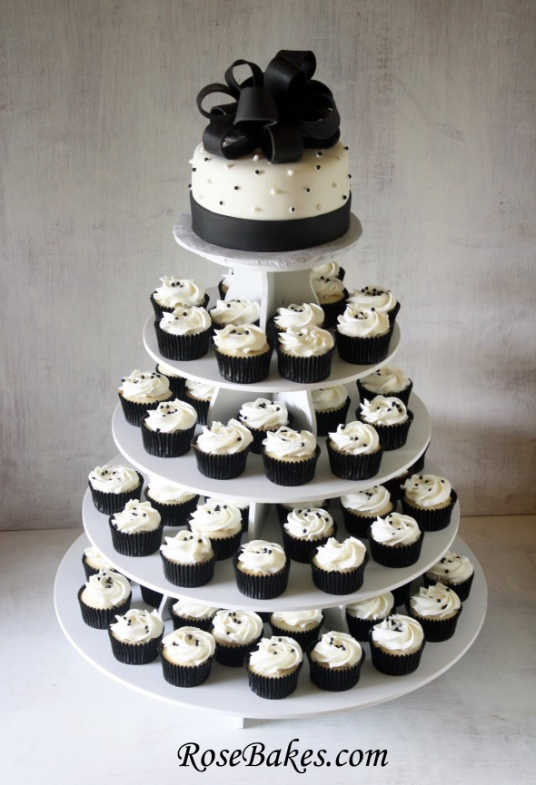http://rosebakes.com/black-white-wedding-cake-and-cupcake-tower/