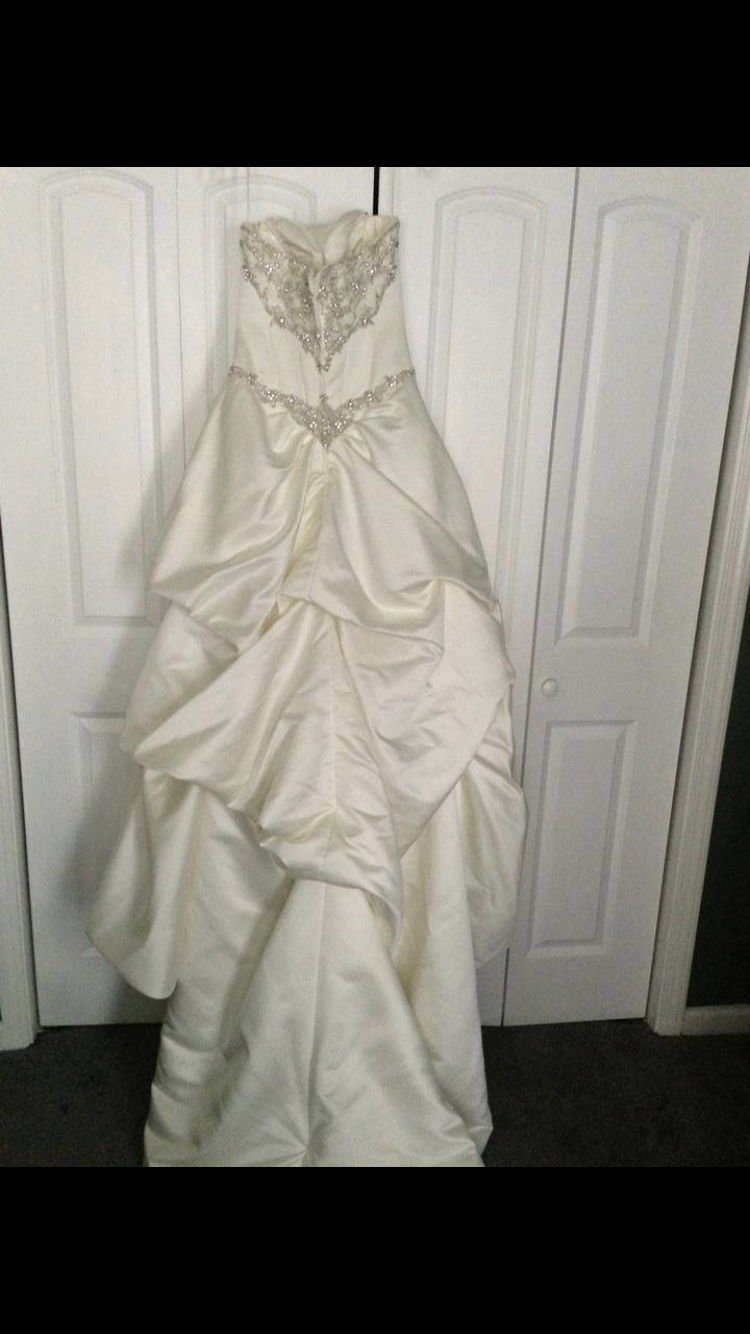 Carrie�s Bridal - Satin Ivory Beaded Ball Gown