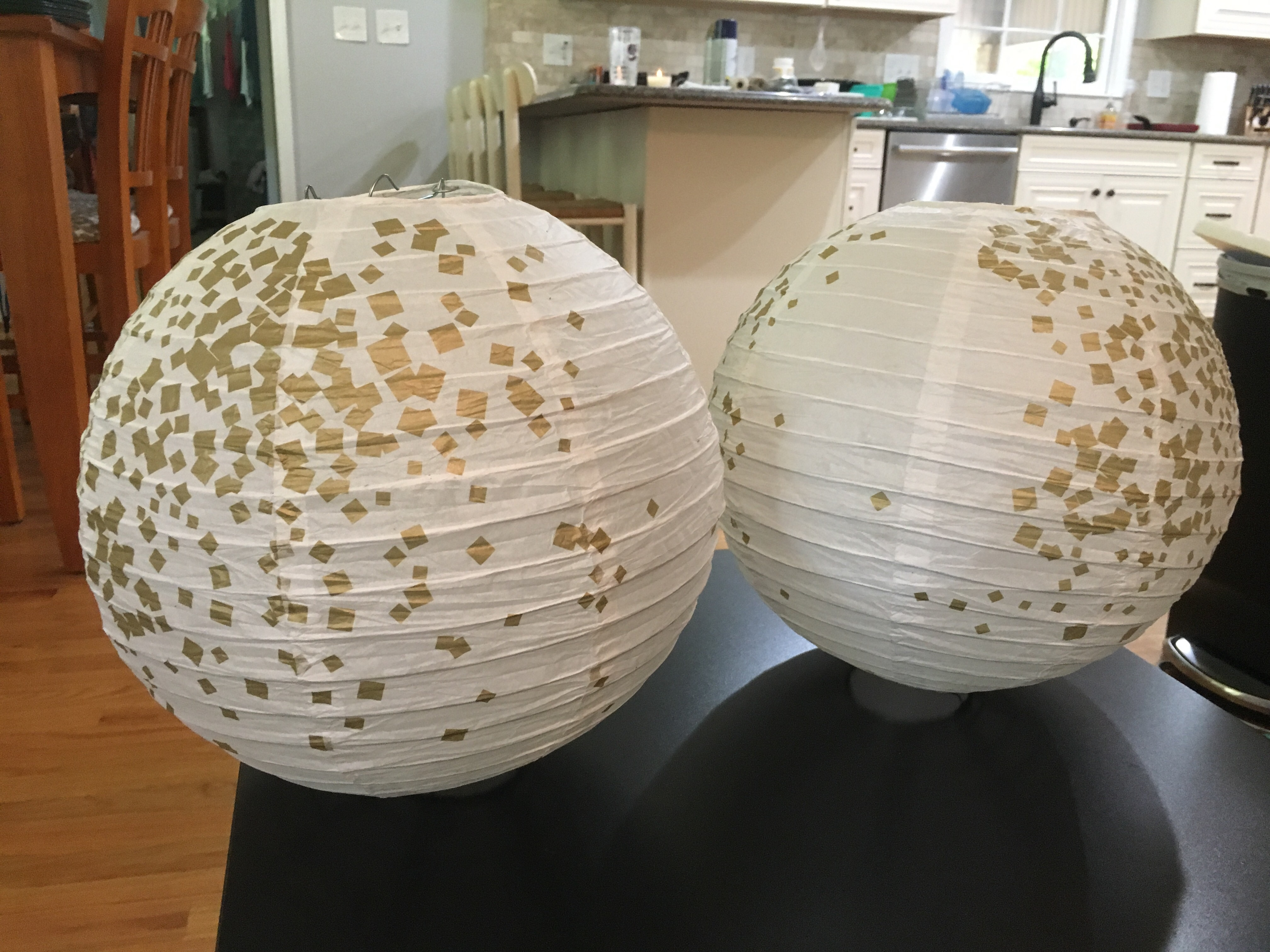 White And Gold Paper Globe Lanterns